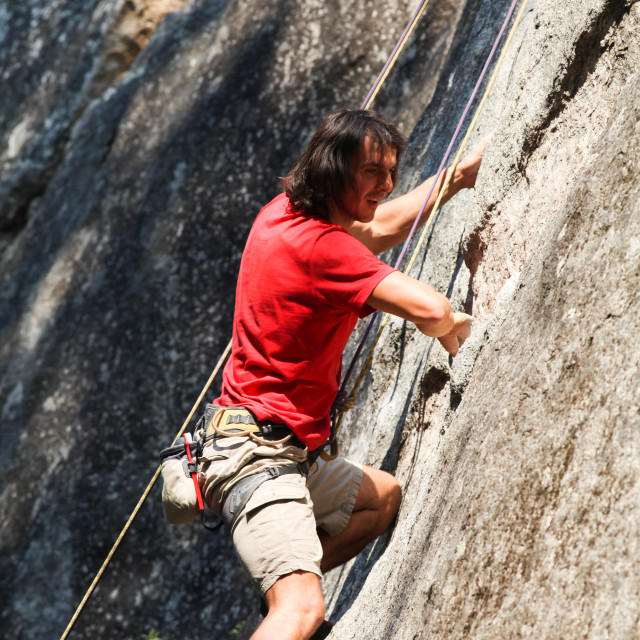 """Rock climber ascends granite wall MR MRA by David Hoffmann, Cali"" stock image"