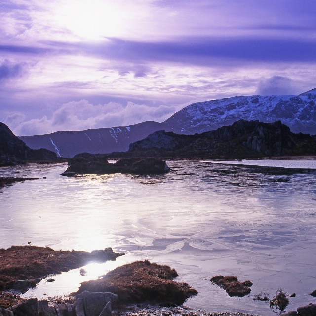 """Mountain tarn in winter"" stock image"