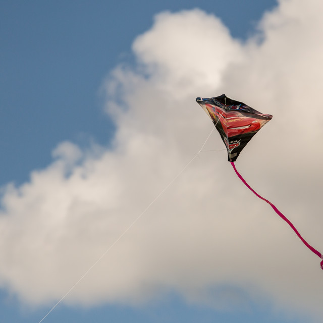 """""""A kite in a clouded sky"""" stock image"""