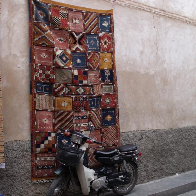 """Motorbike and carpet Marakesh"" stock image"