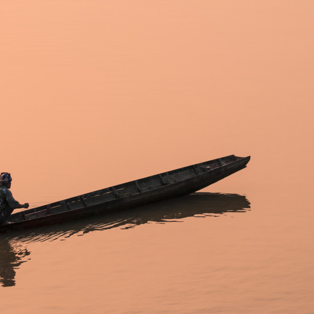 """A Fisherman On The Mekong At Sunset"" stock image"