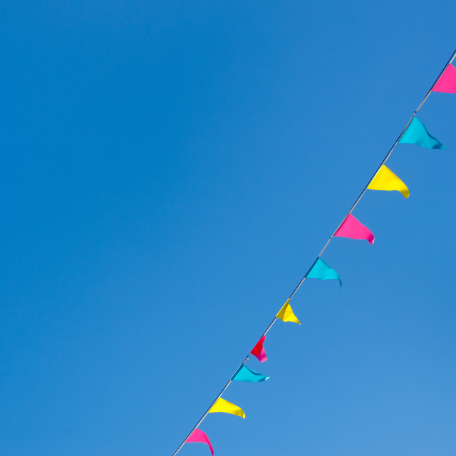 """Bunting against a blue sky"" stock image"