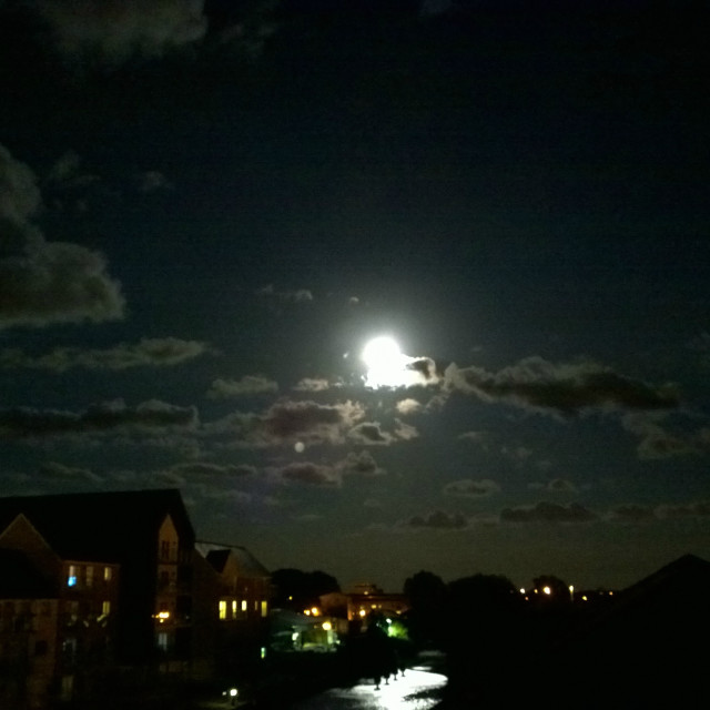 """Supermoon over water"" stock image"