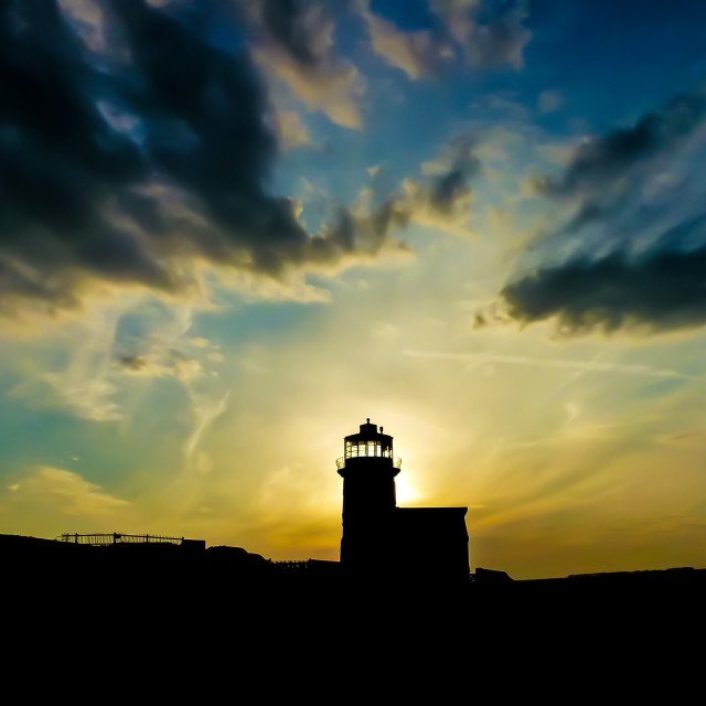 """Sunset behind the lighthouse"" stock image"