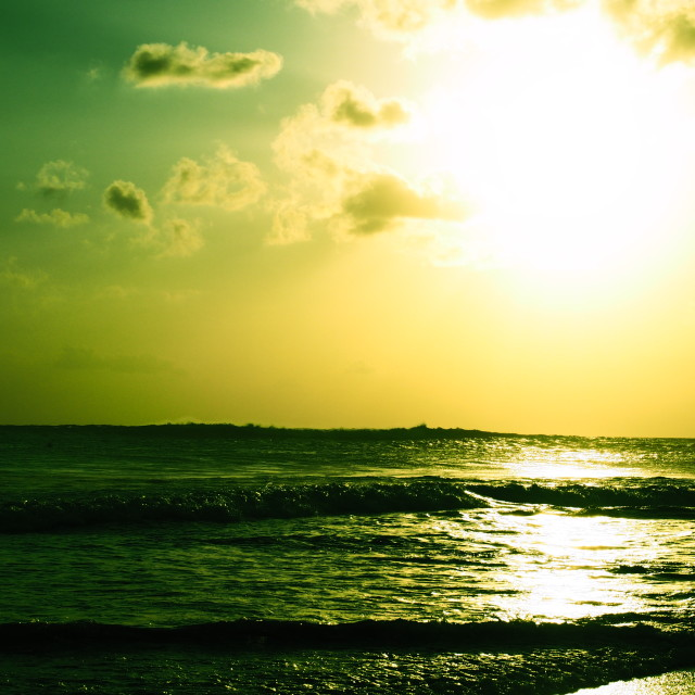 """Sun glare on the ocean"" stock image"