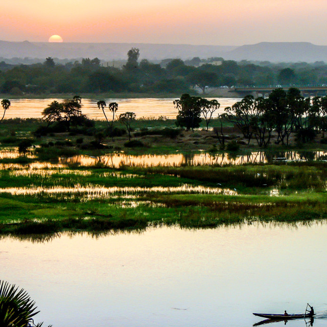 """Traveling the Niger River at Dusk (Niger)"" stock image"