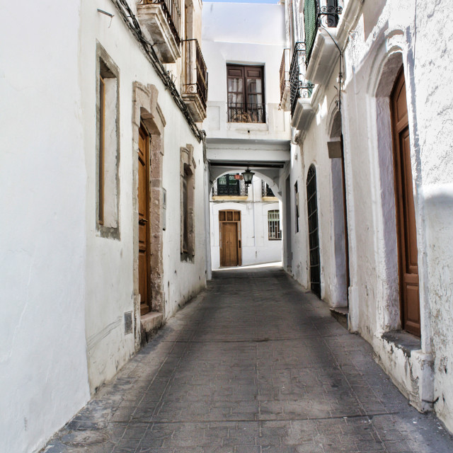 """Typical Whitewashed Andalusian Street in Nijar"" stock image"