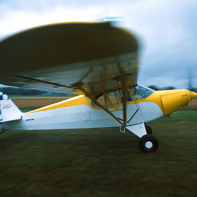"""Bush pilot takes off in Piper PA12 aircraft."" stock image"