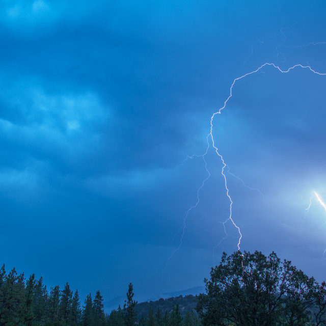 """Lightning strikes in this spectacular early morning shot."" stock image"
