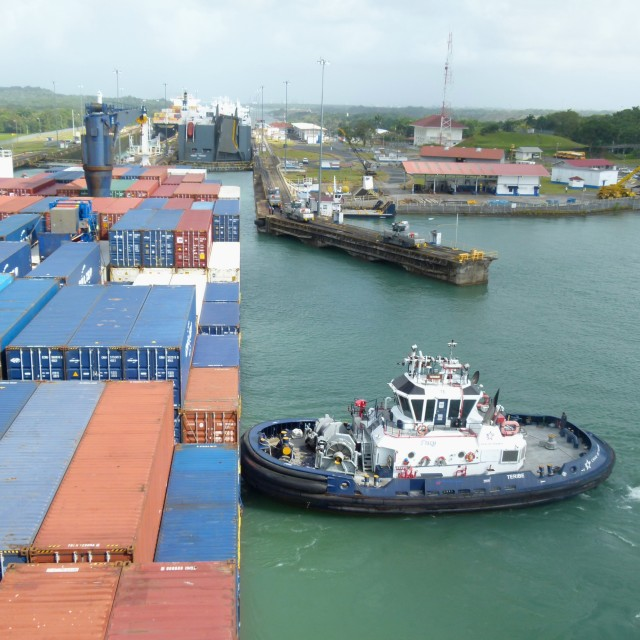 """Cargo ship and tug, Panama Canal"" stock image"