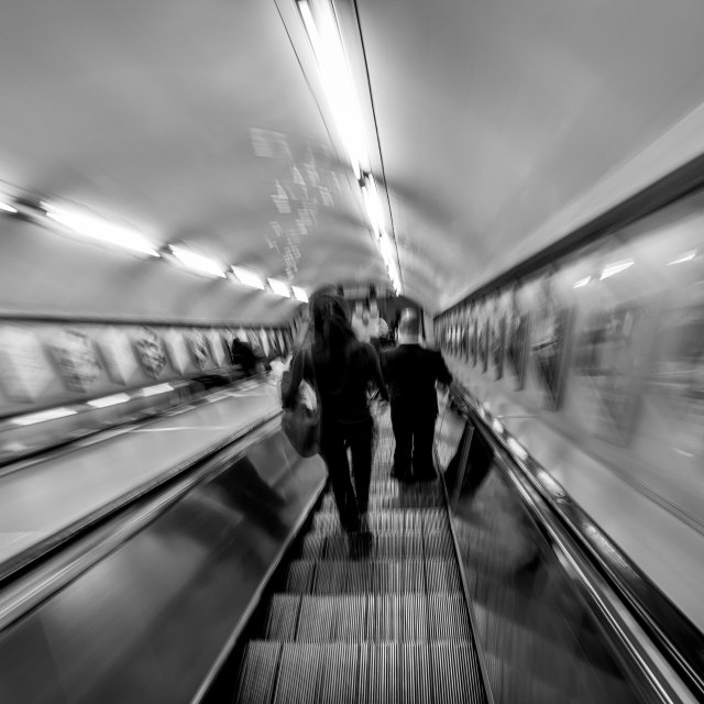 """Descending the escalator"" stock image"