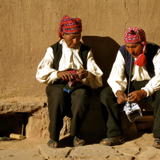 """Men knitting on Taquile Island, Peru"" stock image"