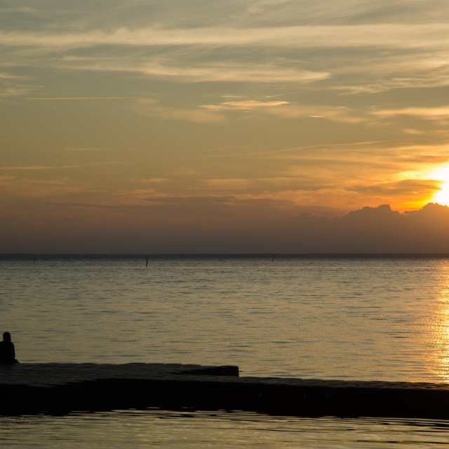 """Couple watching sunset"" stock image"