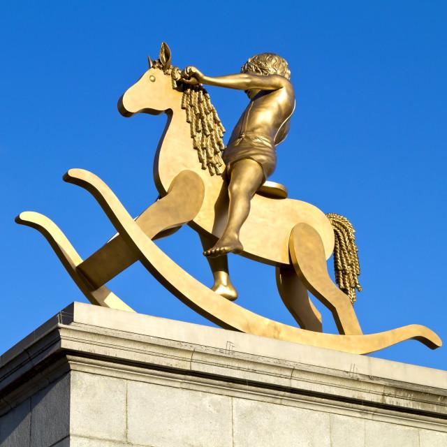 """""""Golden rocking horse"""" stock image"""