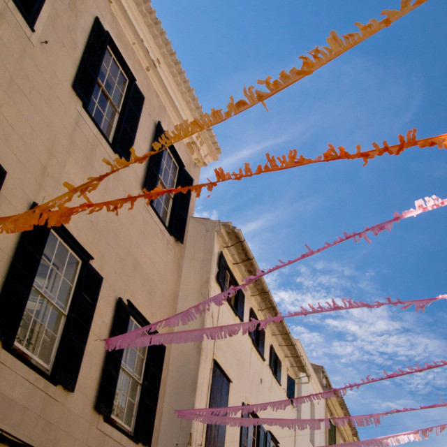 """Vibrant ribbons hung up across one of the streets in the old tow"" stock image"