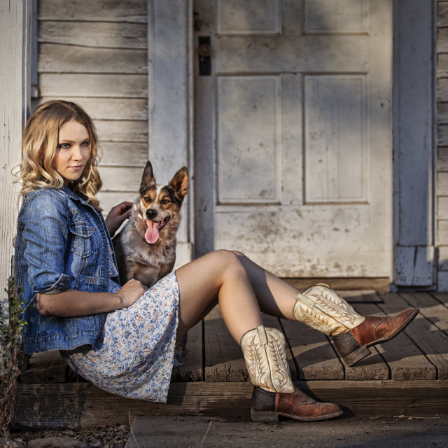 """A Woman and Her Dog On The Front Porch"" stock image"