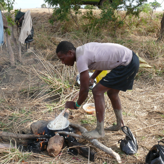 """Cooking African maize porridge outdoors"" stock image"