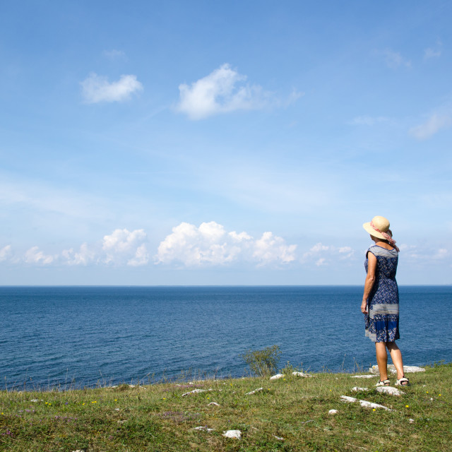 """""""Woman standing by seaside"""" stock image"""