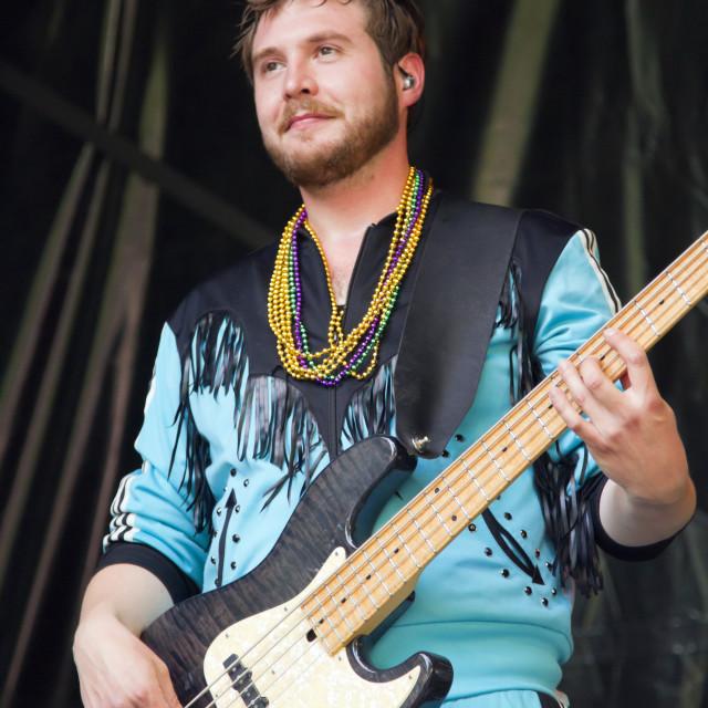 """Buck Wilson plays bass guitar"" stock image"