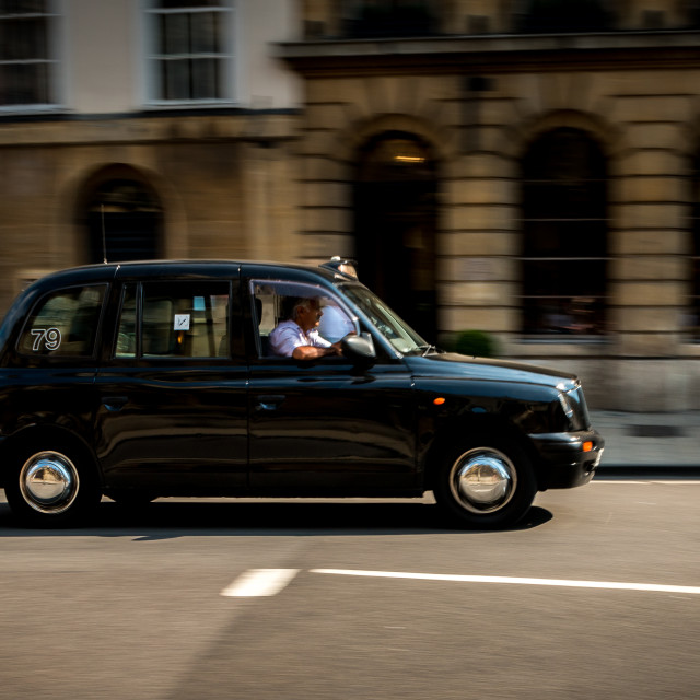 """Panning Black Taxi"" stock image"