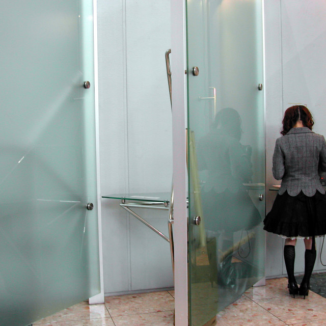 """""""Girl at booth"""" stock image"""