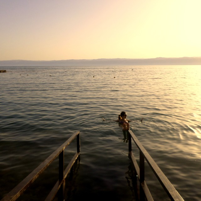"""""""Swimming in the Dead Sea at sunset"""" stock image"""