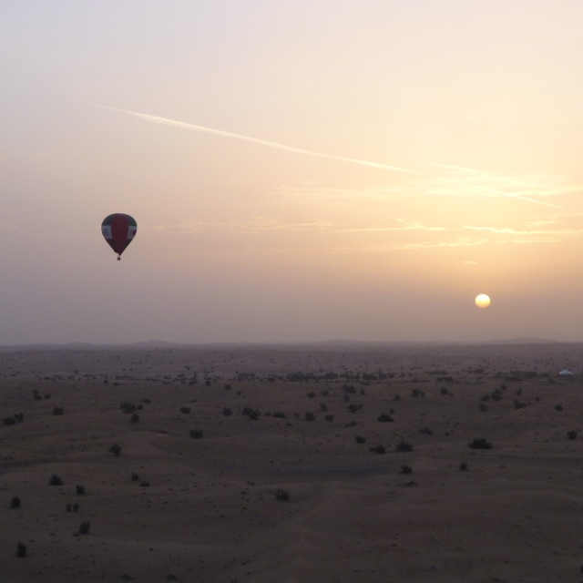 """Hot air ballooning over the desert"" stock image"