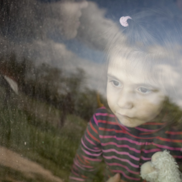 """Little Baby Girl Looking out Car Window Portrait"" stock image"