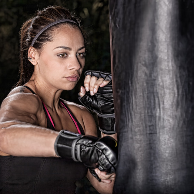 """A Young Woman Training On A Heavy Bag"" stock image"