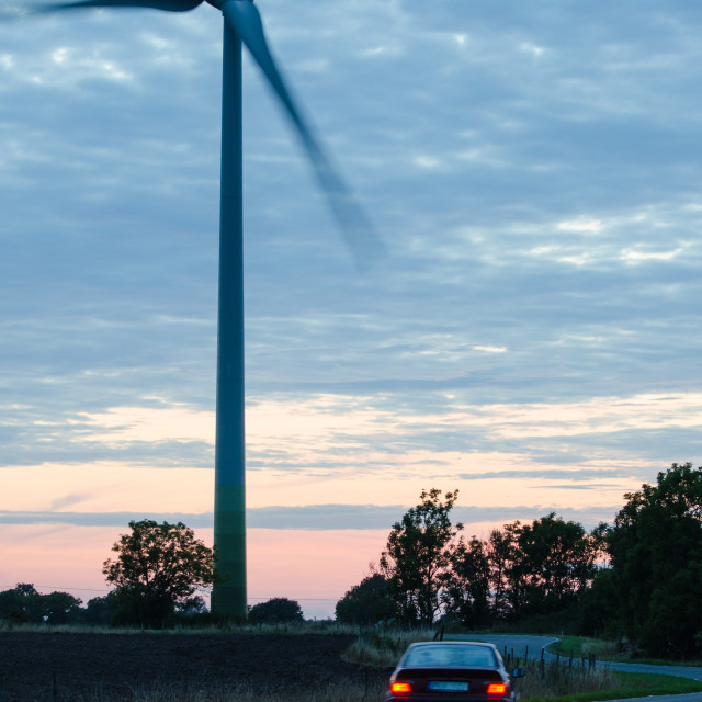 """Wind turbine at a winding road"" stock image"