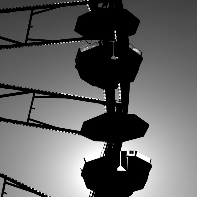 """Silhouette of a ferris wheel"" stock image"