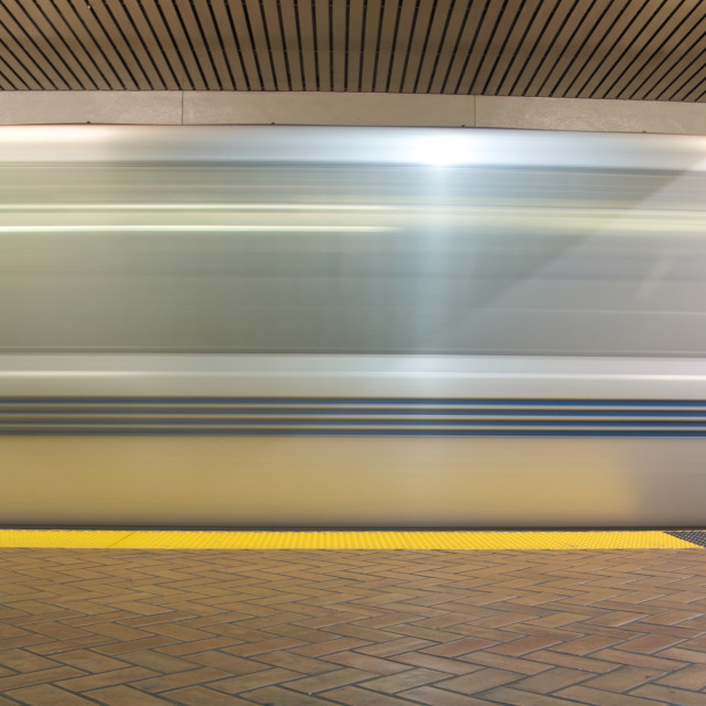 """""""A time exposure of a train in an underground station"""" stock image"""