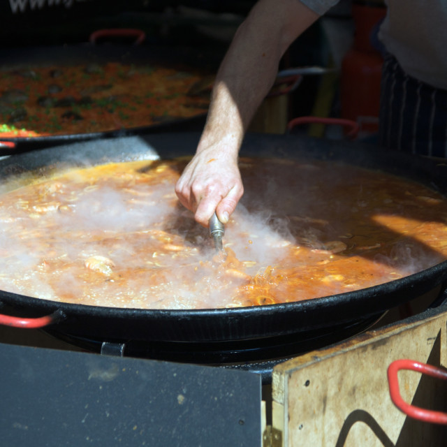 """Cooking food in large pot in outdoor street market"" stock image"