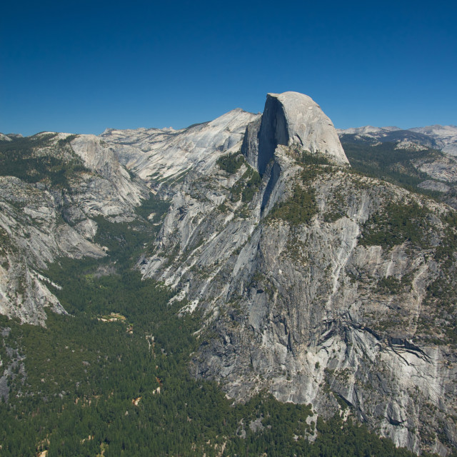 """Clear skies shine down on Half Dome"" stock image"