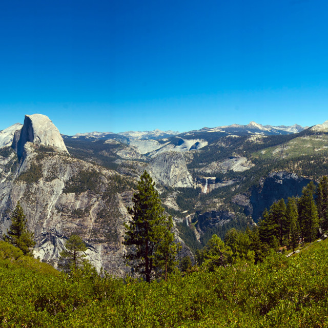 """Panoramic of Half Dome on a cloudless day"" stock image"