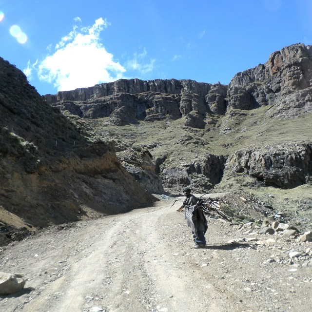 """Lesotho villager climbing Sani Pass"" stock image"
