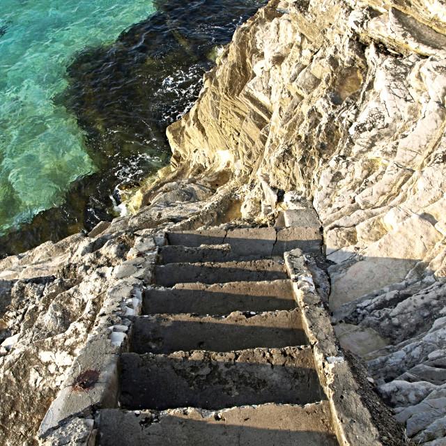 """Stairways, rocks, sea..."" stock image"