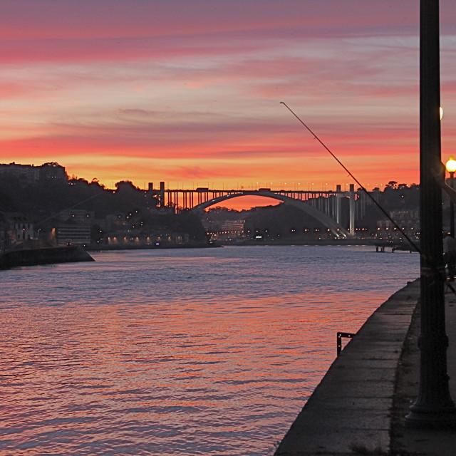 """Portuguese fisherman at sunset"" stock image"