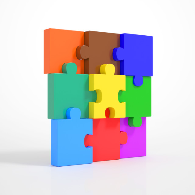 """Pieces of a Puzzle building a Wall"" stock image"