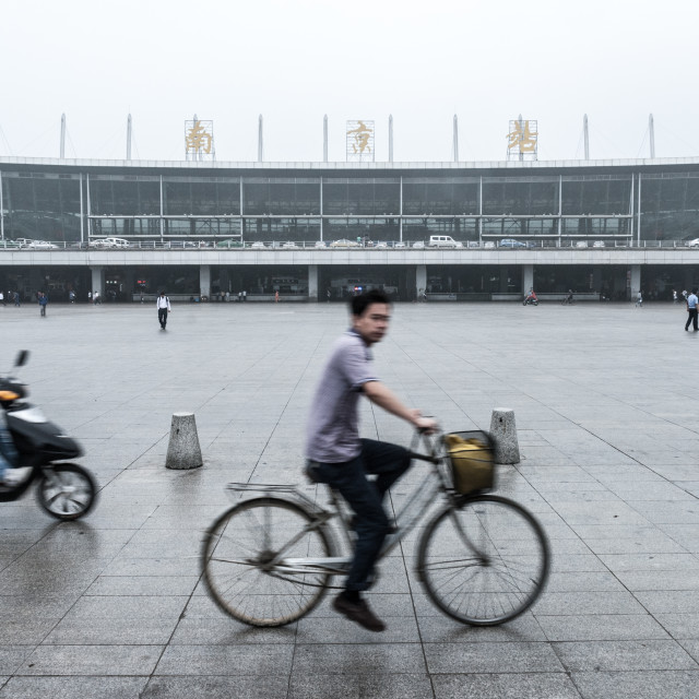 """Nanjing station cyclist"" stock image"