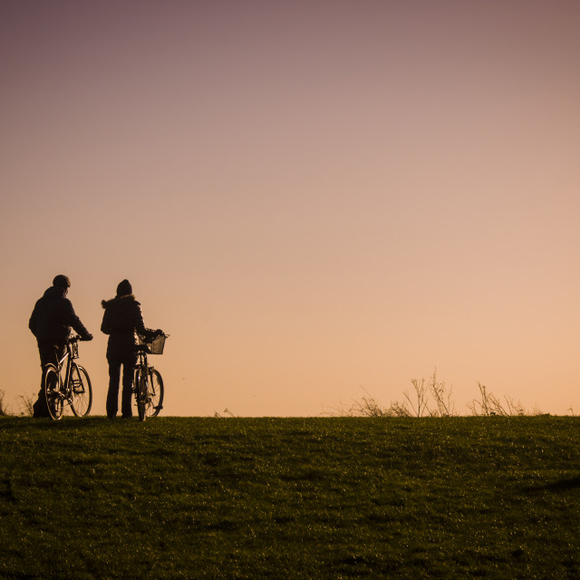 """Cycling towards the sun"" stock image"