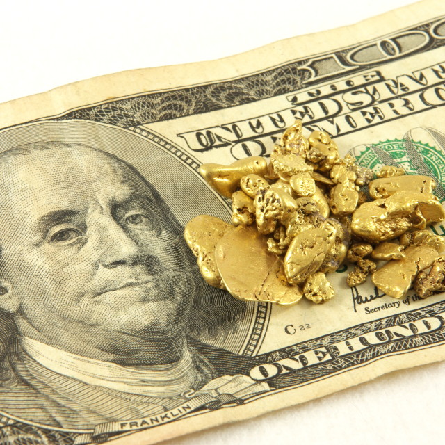 """Gold Nuggets And Hundred Dollar Bill"" stock image"