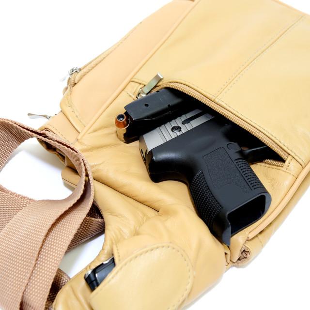 """Purse And Handgun"" stock image"