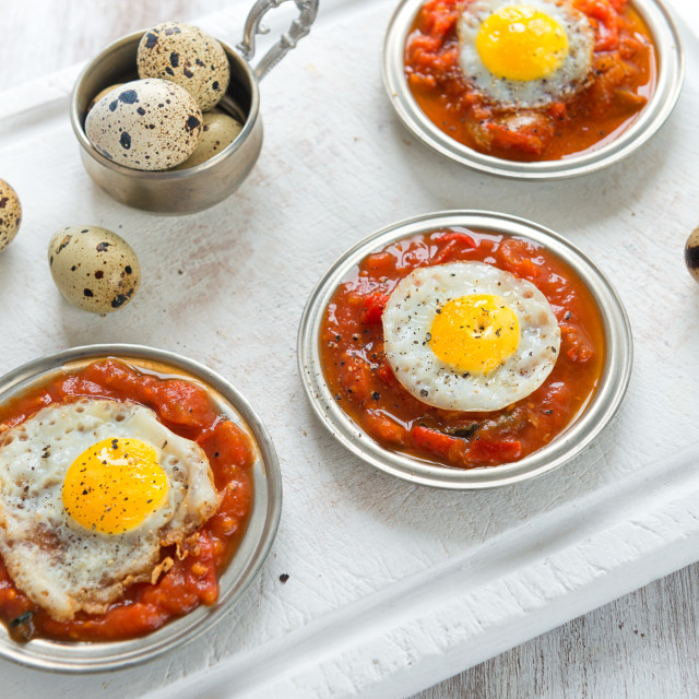 """Omelette of quail eggs with tomato sauce"" stock image"