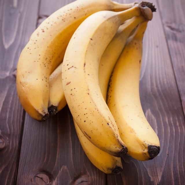 """""""Bananas on wood table"""" stock image"""