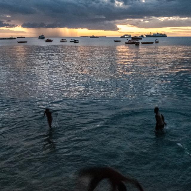 """""""Stone Town beach acrobat"""" stock image"""