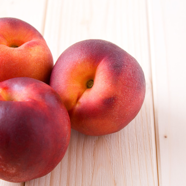 """""""Peaches on wood table"""" stock image"""