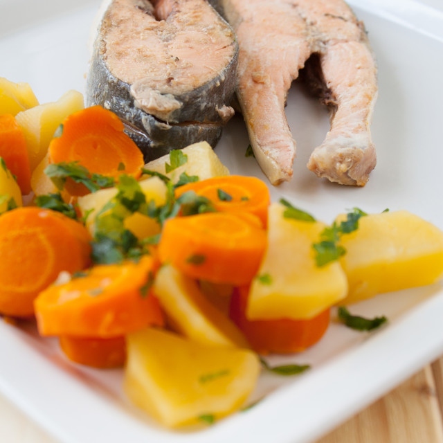 """Salmon steaks with vapor cooked veggies"" stock image"