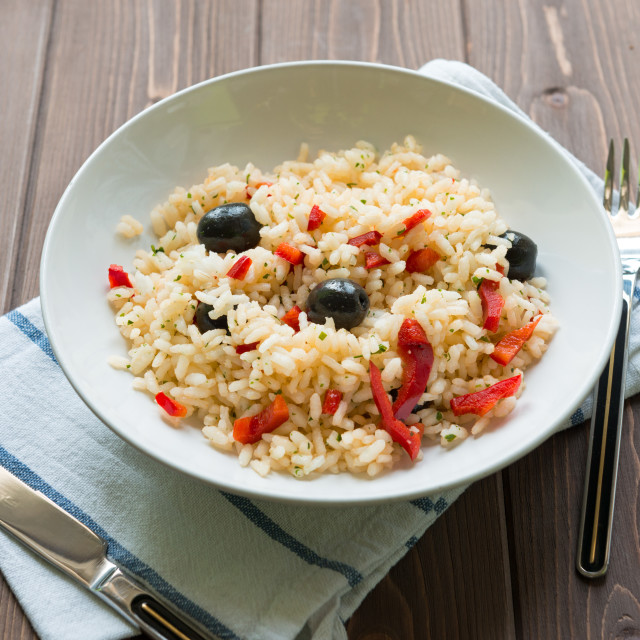 """""""Rice with red capsicum and black olives"""" stock image"""