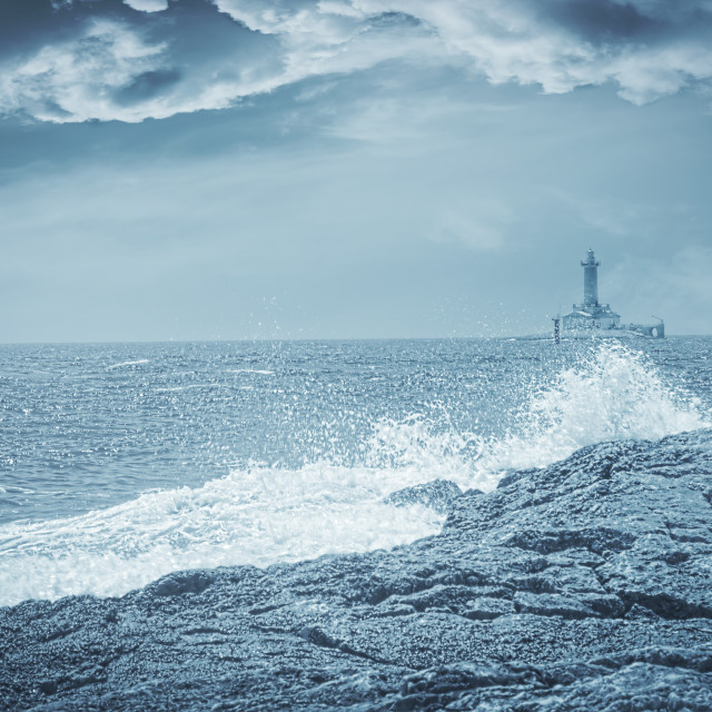 """""""Lighthouse on a stormy day, artistic toned photo"""" stock image"""